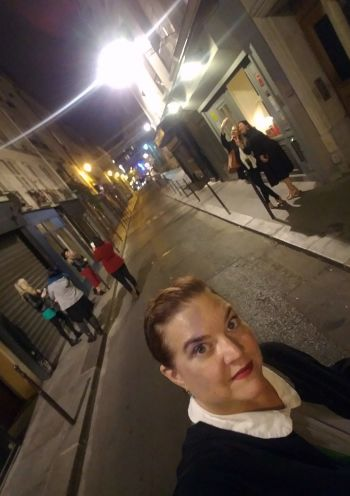 Woman in France taking selfie